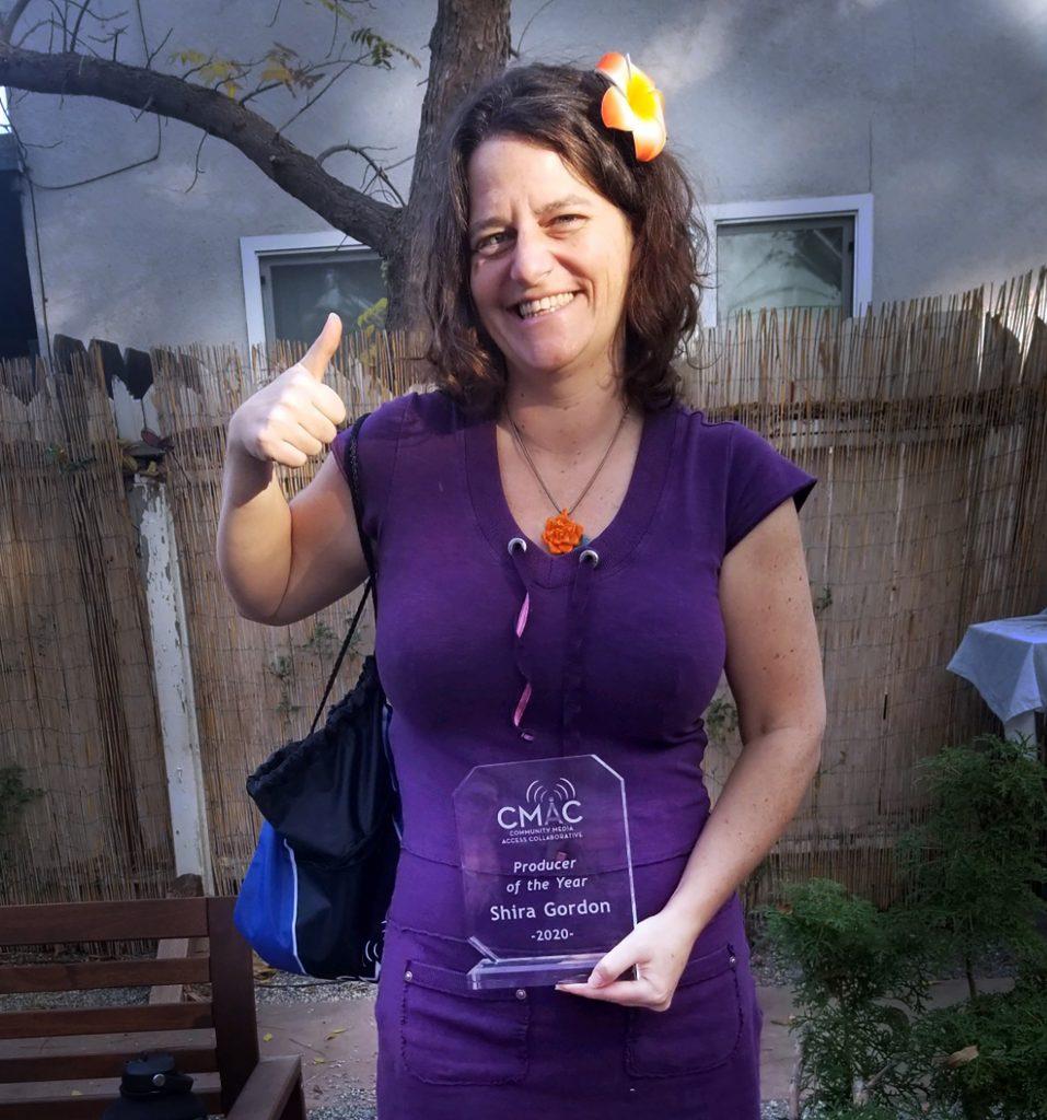 Shira D Gordon holding an award